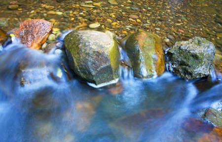 painterly: Water rushing over River Rocks Stock Photo