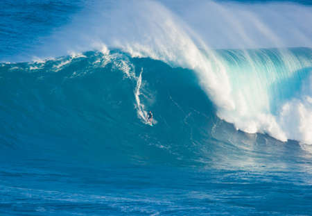 MAUI, HI - MARCH 13: Professional surfer Billy Kemper rides a giant wave at the legendary big wave surf break known as Jaws during one the largest swells of the winter March 13, 2011 in Maui, HI.