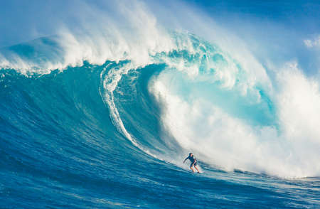 """MAUI, HI - MARCH 13: Professional surfer Billy Kemper rides a giant wave at the legendary big wave surf break known as """"Jaws"""" during one the largest swells of the winter March 13, 2011 in Maui, HI."""