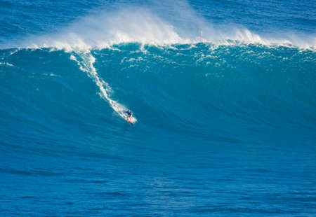 MAUI, HI - MARCH 13: Professional surfer Billy Kemper rides a giant wave at the legendary big wave surf break known as 'Jaws' during one the largest swells of the winter March 13, 2011 in Maui, HI.