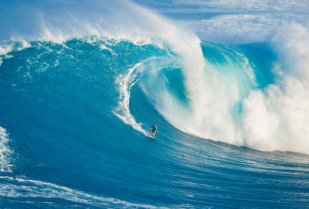 northshore: MAUI, HI - MARCH 13: Professional surfer Billy Kemper rides a giant wave at the legendary big wave surf break known as Jaws during one the largest swells of the winter March 13, 2011 in Maui, HI. Editorial