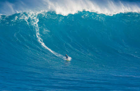 MAUI, HI - MARCH 13: Professional surfer Marcio Freire rides a giant wave at the legendary big wave surf break known as 'Jaws' during one the largest swells of the winter March 13, 2011 in Maui, HI.