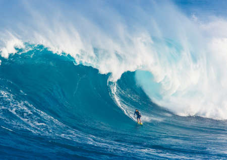 MAUI, HI - MARCH 13: Professional surfer Marcio Freire rides a giant wave at the legendary big wave surf break known as Jaws during one the largest swells of the winter March 13, 2011 in Maui, HI.