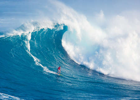 MAUI, HI - MARCH 13: Professional surfer Francisco Porcella rides a giant wave at the legendary big wave surf break Jaws during one the largest swells of the winter March 13, 2011 in Maui, HI.