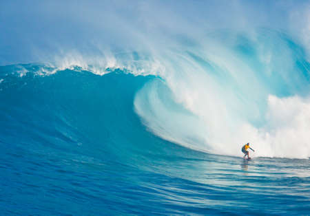 MAUI, HI - MARCH 13: Professional surfer Yuri Soledade rides a giant wave at the legendary big wave surf break known as Jaws during one the largest swells of the winter March 13, 2011 in Maui, HI.