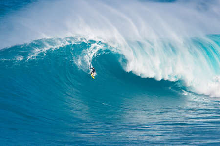 northshore: MAUI, HI - MARCH 13: Professional surfer Carlos Burle rides a giant wave at the legendary big wave surf break Jaws during one the largest swells of the winter March 13, 2011 in Maui, HI.