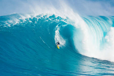 MAUI, HI - MARCH 13: Professional surfer Carlos Burle rides a giant wave at the legendary big wave surf break