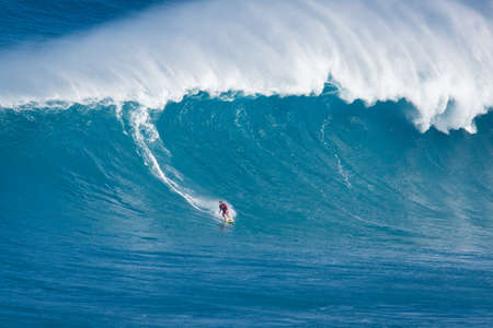 MAUI, HI - MARCH 13: Professional surfer Francisco Porcella rides a giant wave at the legendary big wave surf break Jaws during one the largest swells of the winter March 13, 2011 in Maui, HI. Редакционное