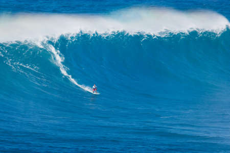 swells: MAUI, HI - MARCH 13: Professional surfer Michel Larronde rides a giant wave at the legendary big wave surf break known as Jaws during one the largest swells of the winter March 13, 2011 in Maui, HI. Editorial