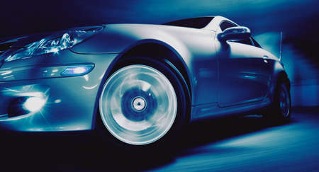 Fancy Sports Car on Road in Motion photo