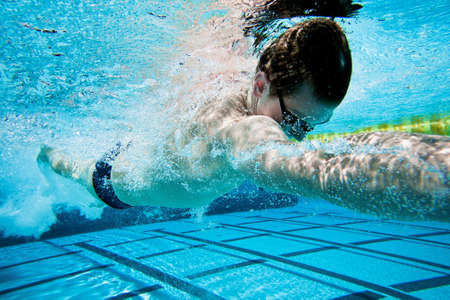 Swimmer Under Water in Pool photo