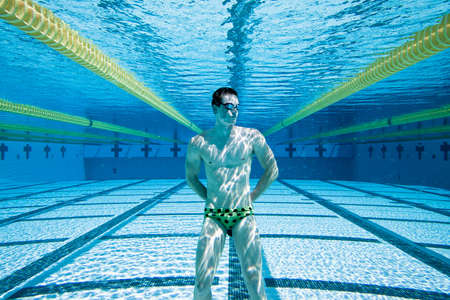 swimming to float: Swimmer Under Water in Pool