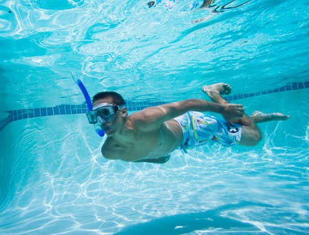 under water: Young Man Swimming Under Water In Pool