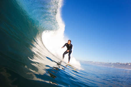 water wave: Surfer on Blue Ocean Wave, View from in the Water Stock Photo