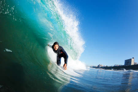 wave: Surfer on Blue Ocean Wave, View from in the Water Stock Photo