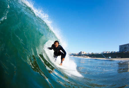 northshore: Surfer on Blue Ocean Wave, View from in the Water Stock Photo