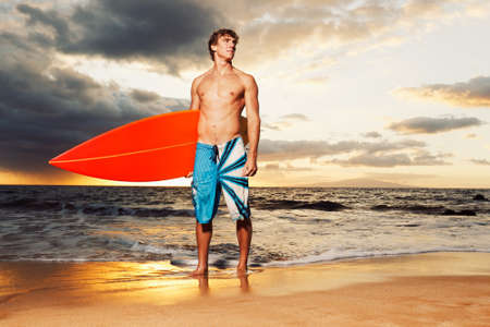 professional surfer holding a surf board photo