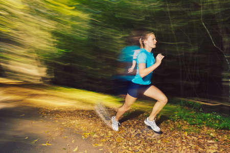 woman running outdoors with motion blur photo