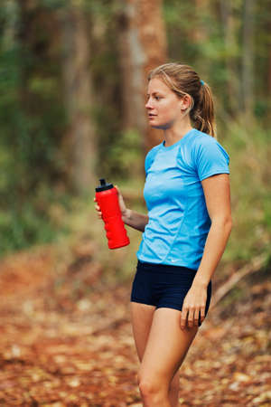 skinny girl: Female Athelete Runner Drinking Water after Jogging