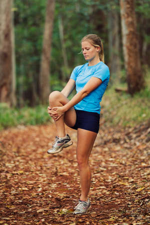 Young Woman Stretching after workout Run photo