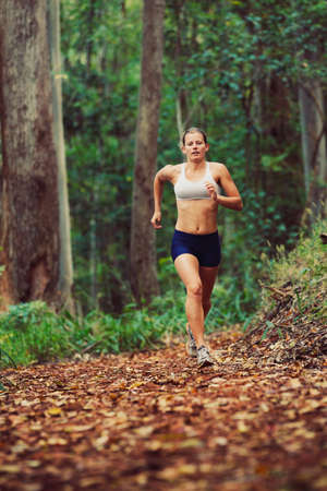 Woman Running Outdoors in Forest photo