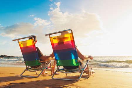 Happy Romantic Couple Enjoying Beautiful Sunset at the Beach Banco de Imagens - 12952674