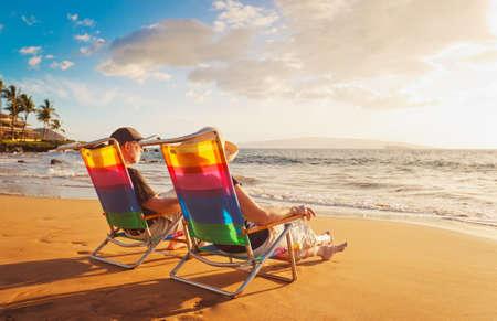 feelings of happiness: Happy Romantic Couple Enjoying Beautiful Sunset at the Beach