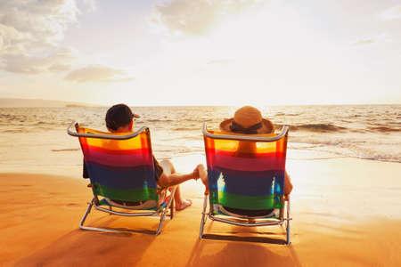 retirement couple: Happy Romantic Couple Enjoying Beautiful Sunset at the Beach