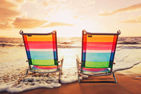 beach sunrise: Hawaiian Vacation Sunset Concept, Two Beach Chairs at Sunset Stock Photo