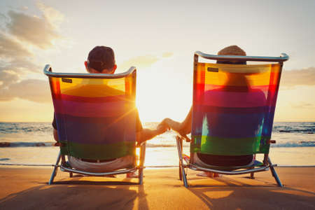 Happy Romantic Couple Enjoying Beautiful Sunset at the Beach photo