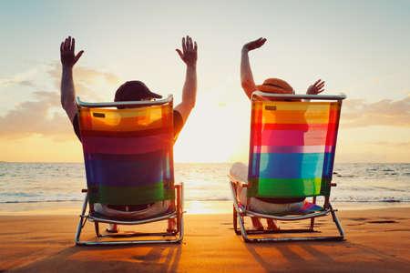 retirement: Happy Romantic Couple Enjoying Beautiful Sunset at the Beach