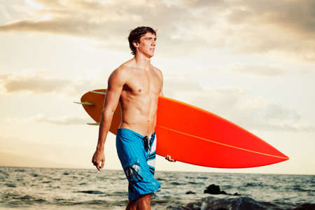 shirtless guy: Professional Surfer holding a Surf Board Stock Photo