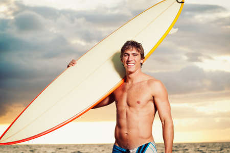 Professional Surfer holding a Surf Board Stock Photo - 13045457