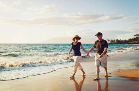 active senior: Senior Couple Enjoying Sunset at the Beach
