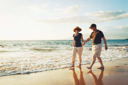 mature couple: Senior Couple Enjoying Sunset at the Beach