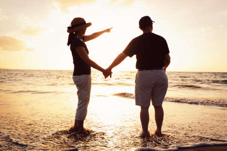 Senior Couple Enjoying Sunset at the Beach Stock Photo - 13045484