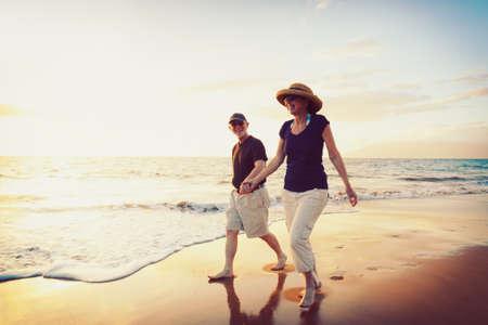 retired couple: Senior Couple Enjoying Sunset at the Beach