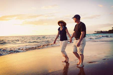 seasides: Senior Couple Enjoying Sunset at the Beach