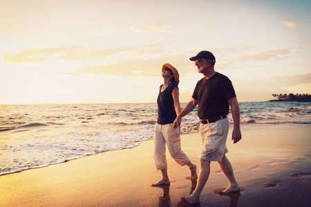 fit couple: Senior Couple Enjoying Sunset at the Beach