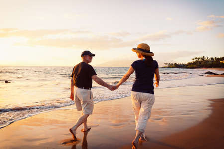 Senior Couple Enjoying Sunset at the Beach photo
