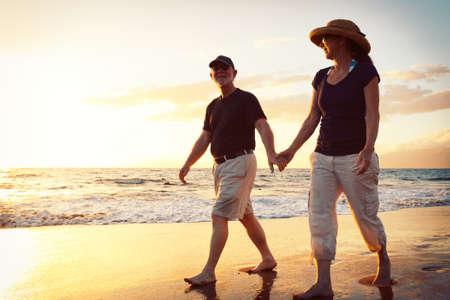 retirement couple: Senior Couple Enjoying Sunset at the Beach