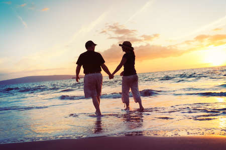 enjoy space: Senior Couple Enjoying Sunset at the Beach