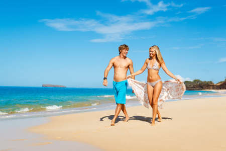 Attractive Young Couple on Tropical Beach Stock Photo