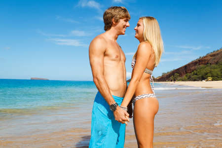Attractive Young Couple on Tropical Beach Stock Photo - 13183894
