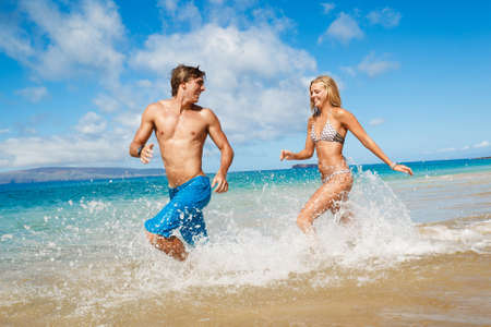 guy on beach: Attractive Young Couple on Tropical Beach Stock Photo