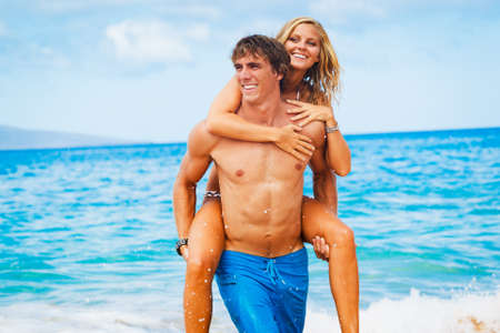 Attractive Young Couple on Tropical Beach photo
