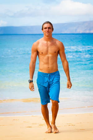 Attractive Young Man on Tropical Beach photo