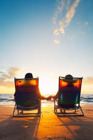 active retirement: Happy Romantic Couple Enjoying Beautiful Sunset at the Beach