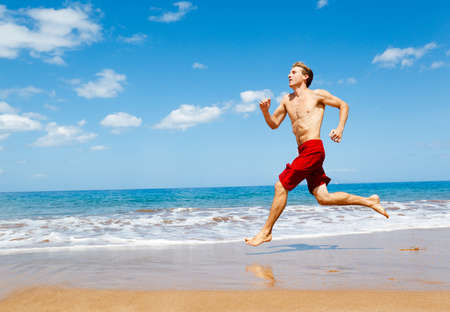 beach hunk: Physically fit man running on Beach