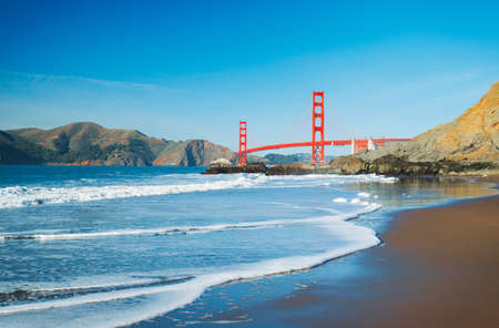 The Golden Gate Bridge in San Francisco with beautiful blue ocean in background photo